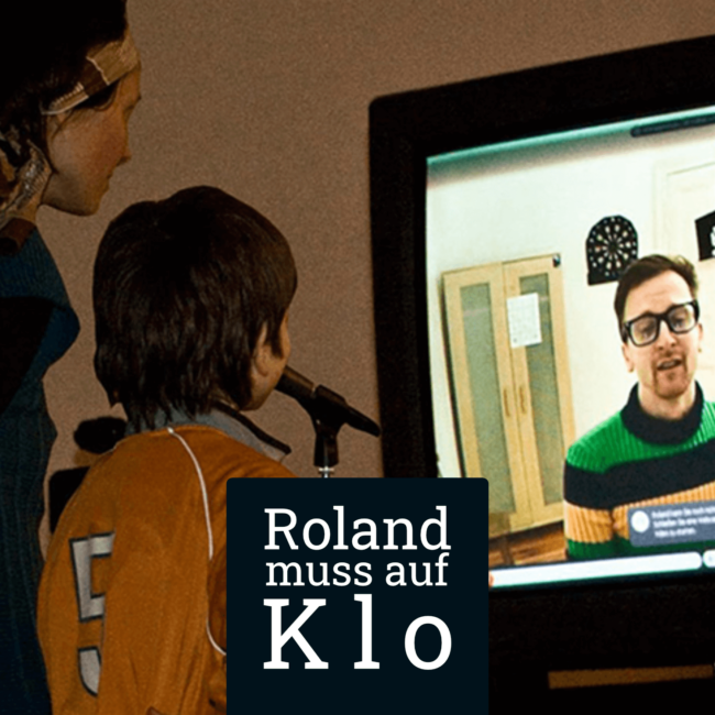 Roland muss auf Klo Portfolio Cover-Bild